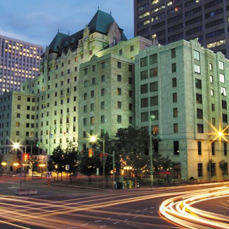 Lord Elgin Hotel downtown Ottawa at dusk - Ottawa Hotel Wedding Venue on Elgin Street overlooking Confederation Park & Rideau Canal