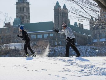 Two people ice tracking in the snow during Winterlude 2019