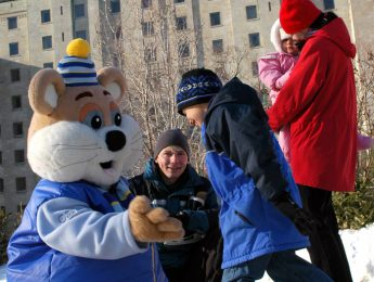 A family having fun during the the Winterlude event in 2019